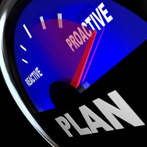 speedometer reading 'reactive' and 'proactive'