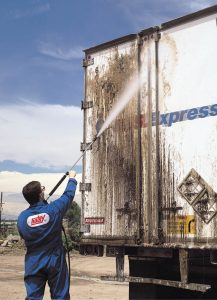 Hotsy hot water pressure washing a truck